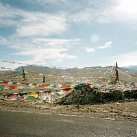 Woman and Prayer Flags' - Himmalayas, Tibet