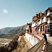 Men Overlooking From Mountain Monestary' - Tibet